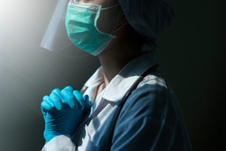 doctor in PPE suit uniform has stress and pray in Coronavirus outbreak or Covid-19, Concept of Covid-19 quarantine.Emotional stress of overworked doctor and medical care team during covid-10 period.