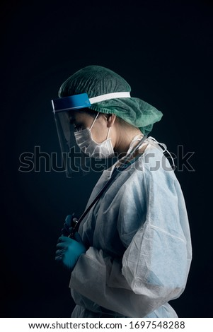 doctor in PPE suit uniform has stress in Coronavirus outbreak or Covid-19, Concept of Covid-19 quarantine.Emotional stress of overworked doctor and medical care team during covid-10 period.