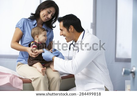 Doctor In Surgery Examining Baby Girl #284499818