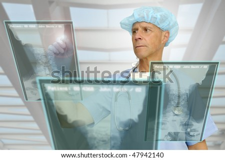 Doctor in uniform with high-tech screen in the hospital