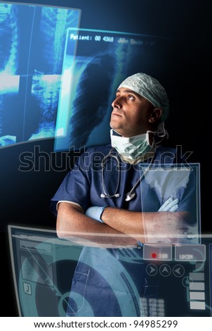Doctor in uniform with X-rays and digital  screens and keyboard