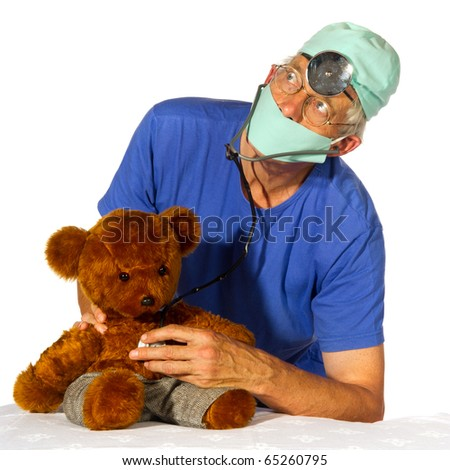 Doctor is having a medical treatment with stethoscope by toy bear