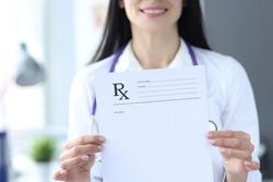 Doctor is holding prescription form for medicines. Prescription drug concept