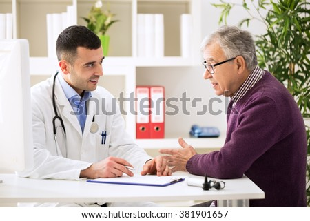 Doctor listening to patient explaining his painful in his office