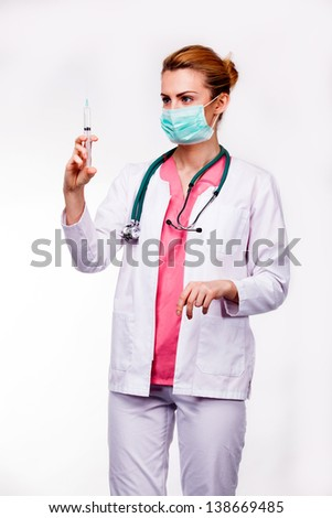doctor looking at syringe on white