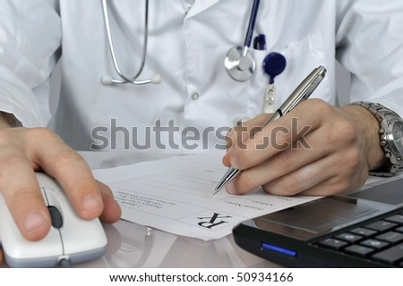 Doctor making prescription working with computer