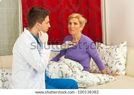 Doctor man examine senior patient woman home