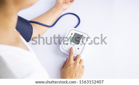 Doctor measuring blood pressure of female patient on white background.Consulting medicine and health care consult healthy lifestyle diagnosis therapeutist practice heal problem reception concept.