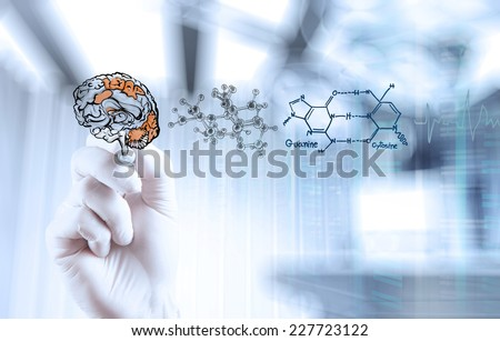 doctor neurologist hand drawing brain with computer interface as concept