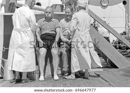 Doctor, nurse and two patients on ship deck