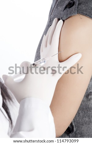 Doctor / Nurse holding a syringe give an injection, on white background