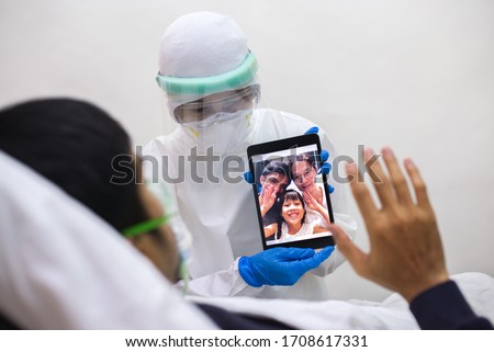 Doctor/Nurse is helping patient  VDO call to his family in the cohort ward of a hospital during the corona virus disease (Covid-19) outbreak Сток-фото ©