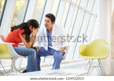 Doctor Offering Counselling To Depressed Woman - stock photo
