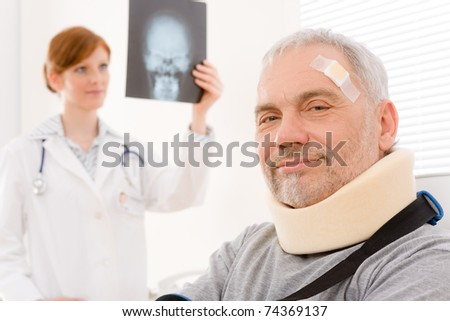 Doctor office - senior patient female physician examine x-ray - stock photo