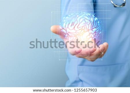 Doctor on blurred background using digital brain scan hologram 3D rendering Stockfoto ©
