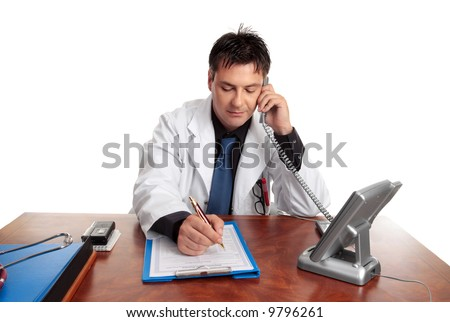 Doctor on the phone fills out patient information sheet.