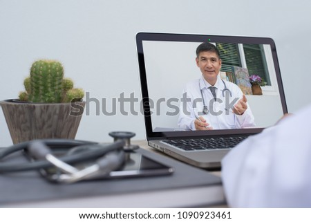 Doctor on video conference or teleconference, dicussing on case study via laptop computer in doctor room. Medical student studying with professor on internet channel. Telemedicine concept