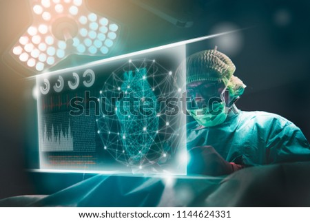 Doctor operation in operation room at hospital.surgeon analyzing patient heart testing result on technological digital futuristic virtual interface, digital holographic.innovative concept.