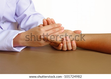 doctor or physical therapist giving exercise hand  in a health center