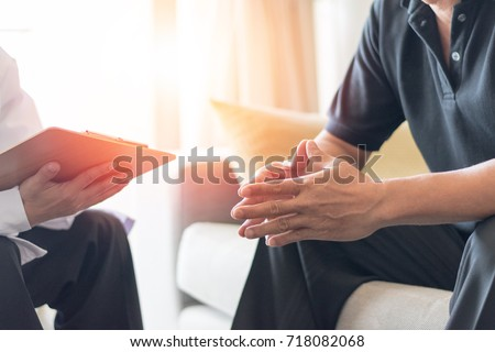 Doctor physician consulting with male patients in hospital exam room. Men's health concept. Psychologist consult in psychotherapy session.