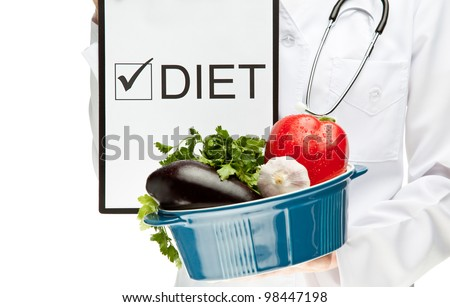 "Doctor prescribing diet; closeup of doctor's hands holding clipboard with marked checkbox ""Diet"" and brazier with fresh vegetables; dietary concept isolated on white"