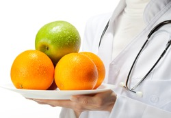 Doctor prescribing healthy eating: closeup of doctor's hands holding plate with fresh fruits; isolated on white background