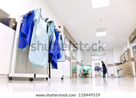 Doctor protective uniforms for surgery hanging in a light hospital corridor