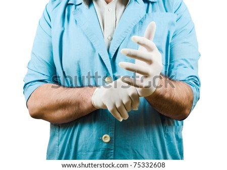 Doctor puts on rubber gloves