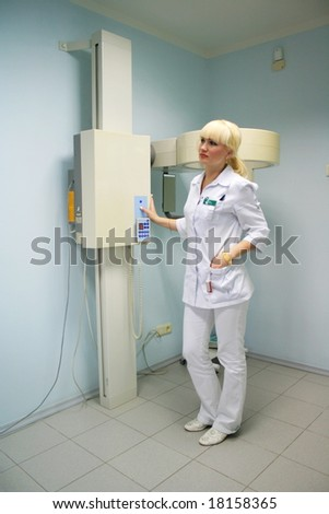 doctor-radiologist connects the equipment for reception of x-ray pictures
