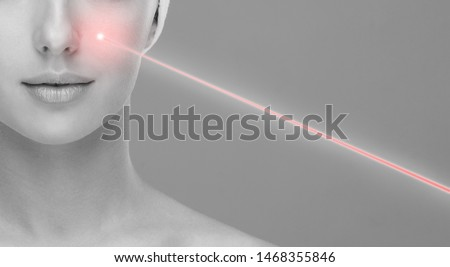 Doctor removing moles using laser ray. Beauty portrait of a young woman. Birthmark removal, plastic surgery, skin lifting and aesthetic medicine.