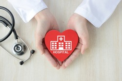 Doctor's hands and heart object with hospital pictogram