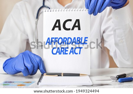 Doctor's hands in blue gloves holding a sheet of paper with text ACA. aca - short for affordable care act, medical concept. Imagine de stoc ©