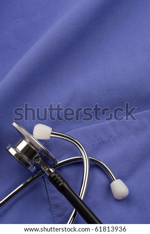 Doctor's stethoscope on scrubs.  Concept of healthcare or medical.