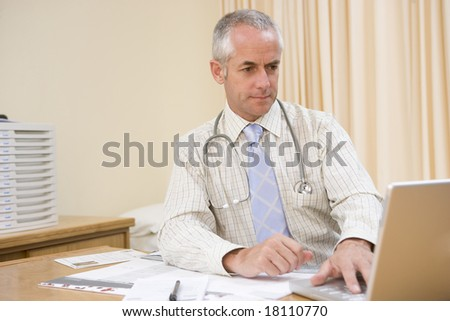 doctor sat at office desk working