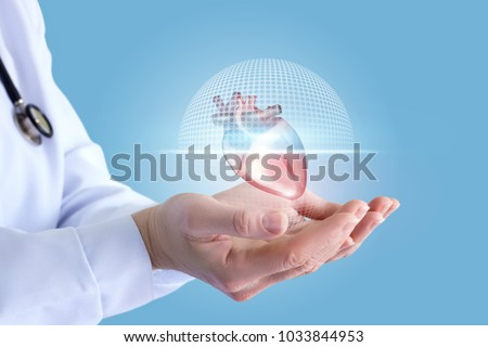 Doctor shows in the hands of a scanning of the heart on a blue background.