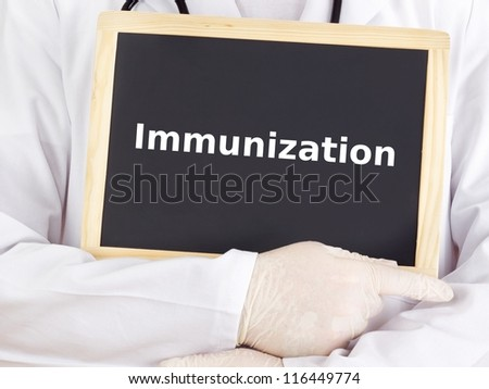 Doctor shows information: immunization - stock photo