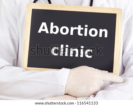 Doctor shows information on blackboard: abortion clinic