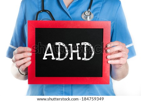Doctor shows information on blackboard: adhd