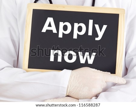 Doctor shows information on blackboard: apply now - stock photo