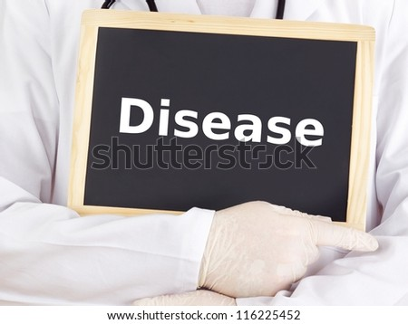 Doctor shows information on blackboard: disease - stock photo