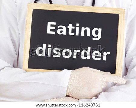 Doctor shows information on blackboard: eating disorder