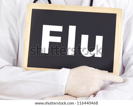 Doctor shows information on blackboard: flu