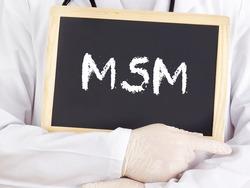 Doctor shows information on blackboard: MSM