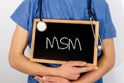 Doctor shows information on blackboard: msm.  Medical concept.