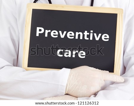 Doctor shows information on blackboard: preventive care