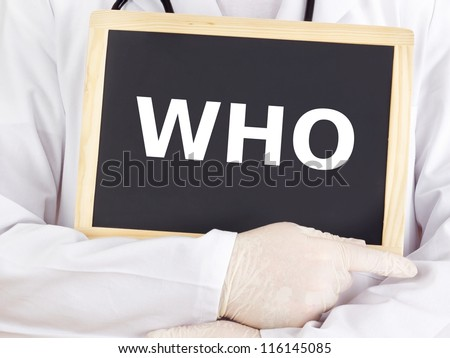 Doctor shows information on blackboard: who