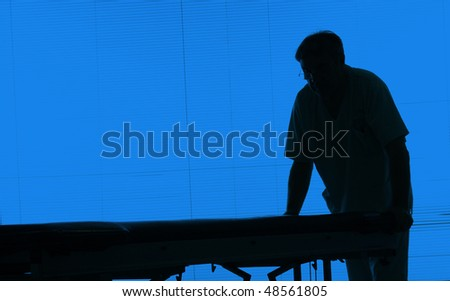 Doctor silhouette with an hospital bed at a hospital