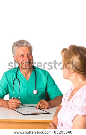 doctor sits at table with a patient