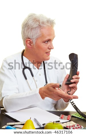 Doctor sitting at his desk and making a phone call