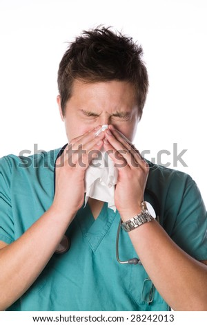 Doctor sneezing isolated against white background - stock photo